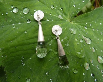 Earrings/studs made out of sterling silver, with beautiful facetted briolettes of prasiolithe, a green variety of amethyst