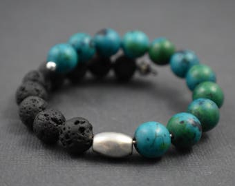 Bracelet- One size fits all. Volcanic stone and turquoise beads