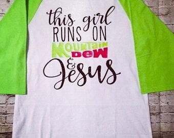 This Girl Runs on Mountain Dew and Jesus raglan