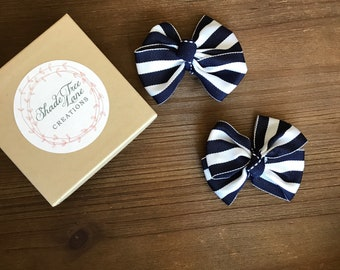 Navy blue and white stripe bow hair clips