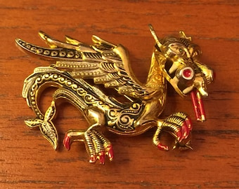 Beautifully detailed vintage oriental dragon brooch in gold tone and red 1980's
