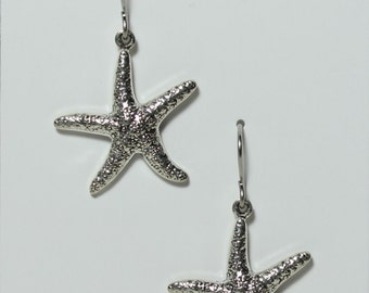 Star fish earrings on hypoallergenic surgical steel ear wires