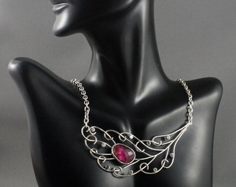 Jewelry with meaning. Sterling silver Peacock Feather necklace. Pink tourmaline jewelry. Elegant jewelry.
