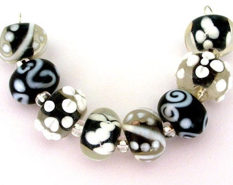 6 black and white floral lampwork beads