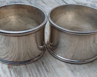 Two white metal napkin rings