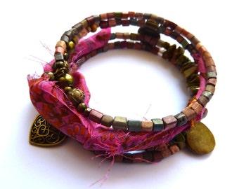 Multi-strand bracelet-style ethnic rock & piece of silk