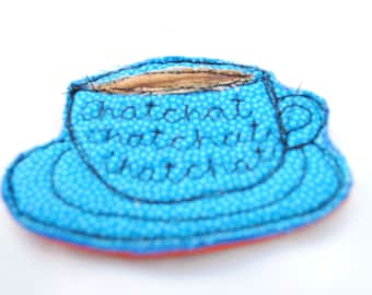 Felt and fabric machine embroidery textiles quirky 'chatting' teacup brooches sewn with words