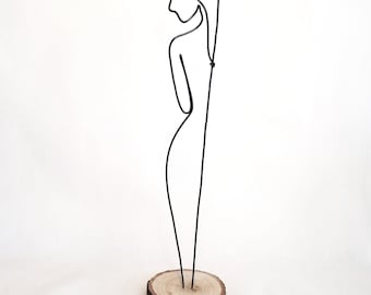 Wire sculpture of standing woman