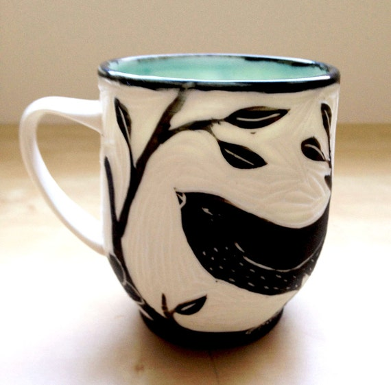 Porcelain Hand Carved Cup with Black Bird