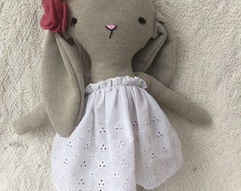 Large Bunny rabbit plush with felt flowers sewn to the ear