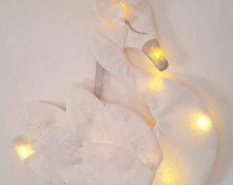 Swan-shaped night light in white linen