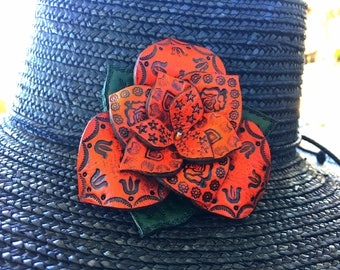 Tooled Leather Flower Clips for your hair, hat or clothing.