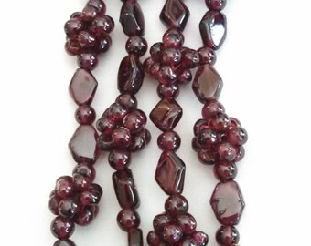 "Single strand beaded garnet necklace, rosettes and diamonds, 29"", no clasp"