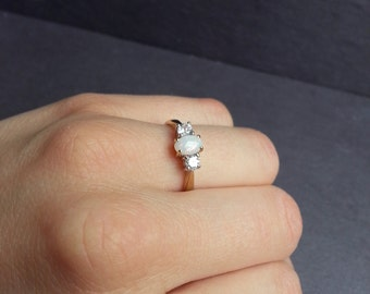 Diamond & Opal Engagement Ring in Yellow Gold