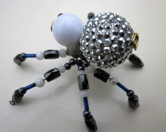 Spider beaded  white,black.silver,blue on legs..