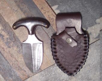 Custom handmade Damascus steel firestorm pattern tactical dagger with Micarta handle and custom hand tooled leather sheath