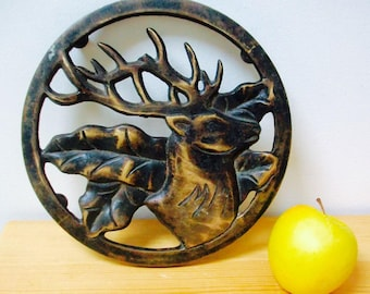 Vintage French burnished brass trivet with stags head design