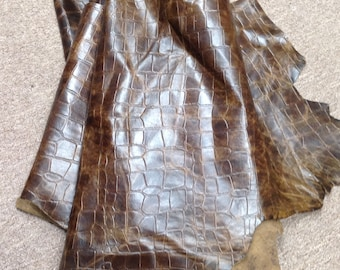 6-781.  Distressed Brown Embossed Reptile Leather Cowhide Partials