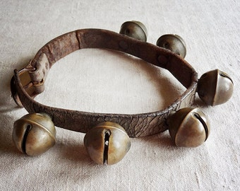 vintage sleigh bells on leather strap, 6 brass bells from an old horse sleigh harness