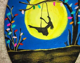 Girl swinging from tree painting