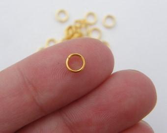 200 Split rings 5mm gold tone