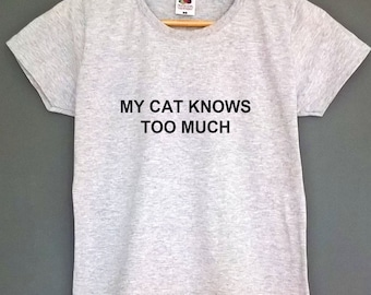 My cat knows too much shirt cat tshirt top cat lover tee gifts for cat lovers womens clothing t-shirt womens shirt meow top kitty tee top