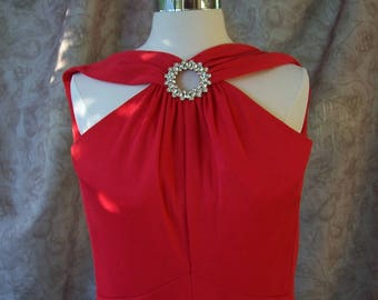 Vintage 1970s red polyester jumpsuit with rhinestone accent .  T798-3.