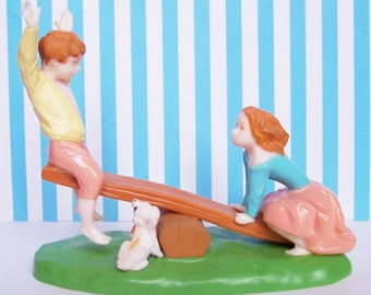 """Wilton Children on a Seesaw Cake Topper Figurine 5"""" tall, Base is 6"""" wide New Old Stock 1973"""