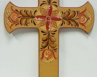 folk art wall cross, natural wood color background