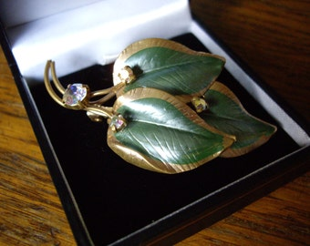 50's ? brooch with green and gold leaves, with aurora borealis stone accents. Made in Austria.
