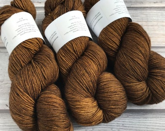 Mericash Fingering in colorway Brown Butter by Skeinny Dipping Yarn; SW Merino Cashmere Nylon sock yarn