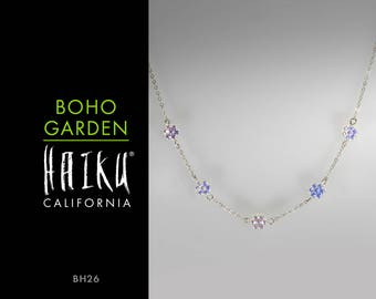 Boho Garden by HaikuCalifornia: Iridescent white daisy glass flowers necklace with silver chain.