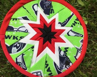 Seahawks-themed quilted star potholder/trivet