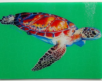 Speedy Sea Turtle Swimming Reef on emerald green glass Cutting Board serving tray