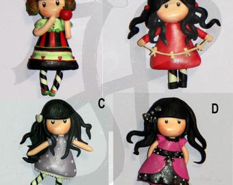 Refrigerator magnets with little dolls