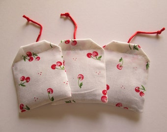 Set of three (3) teabag shaped kitten, cat toy with all natural catnip in a cheery cherry fabric