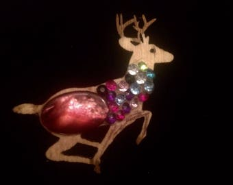 Cute leaping Reindeer brooch. Handcrafted from wood ready for Christmas.