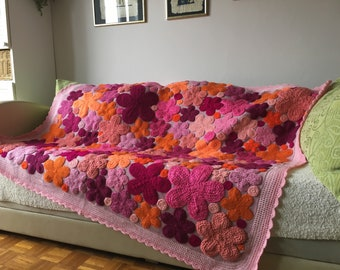 Blanket with crocheted flowers