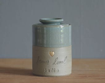 custom urn with ceramic lid. gold accent stamp shown, custom name and color. modern urn for ashes. Ice blue on sand