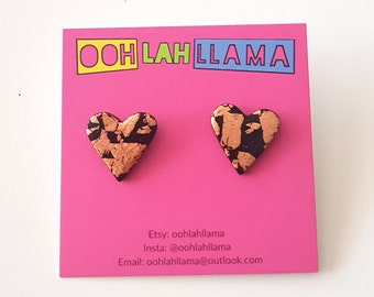 Foiled. Black polymer clay and copper leaf heart shaped studs.