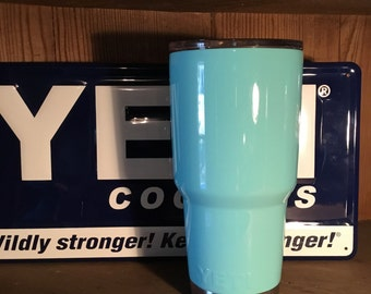 Authentic Powder Coated 30oz Yeti in light teal blue with silver base