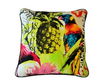 Flamingo ,  Lorrikets , pineapples and flowers on this large print brightly coloured cushion cover . This listing is for a Pair of covers .