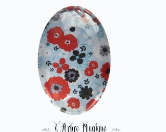 Small red flower cabochon background blue Ref83