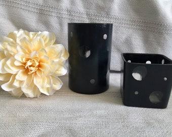 2 dark grey glass jars