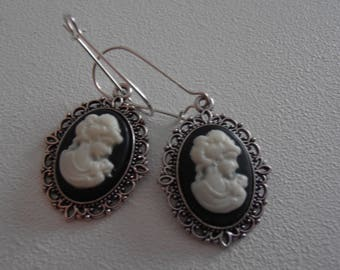 Metal with black and white cameo earrings