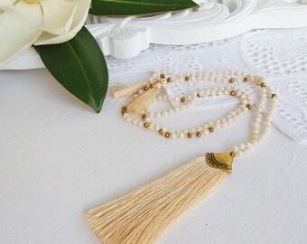 Cream and gold crystal bead  tassel necklace with a cream tassel