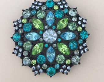 Lovely vintage blue flower brooch .