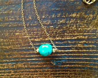 Amazing Turquoise bead with gold rondelles on fine gold chain with gold lobster claw