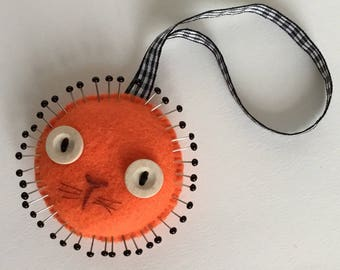 Orange felt lion pincushion