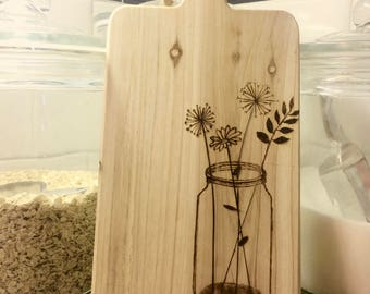Jar and flowers cutting board